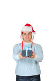 Young man in santa's hat holding present box Stock Photo
