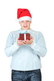 Young man in santa's hat holding present box Stock Photography