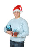 Young man in santa's hat holding present box Royalty Free Stock Images