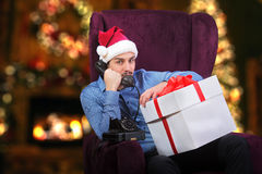 Young man in Santa's red hat Stock Photography