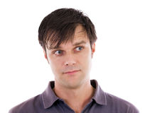 Young man with satisfied look. Portrait of a young man with a satisfied look aimed on the left Stock Photos