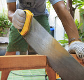 Young man sawing wood at home use for diy working and home maint Royalty Free Stock Photography