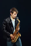 Young man with saxophone Royalty Free Stock Images