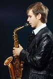 Young man with saxophone Royalty Free Stock Photography