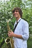 Young man with saxophone Stock Photos
