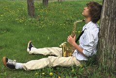 Young man with saxophone Royalty Free Stock Image