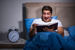 The young man scared in bed. Young man scared in bed Stock Images