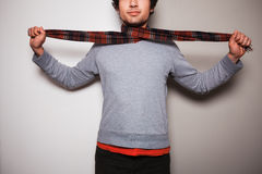 Young man with a scarf against split colored background Stock Images