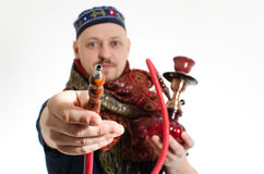 Man offers waterpipe Royalty Free Stock Photo