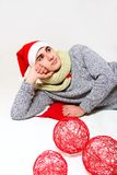 Young man with a scarf, hat santa claus and red balls  o Stock Photo