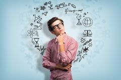 Young man scientist with glasses thinking Stock Photo