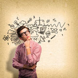 Young man scientist with glasses thinking Royalty Free Stock Photography