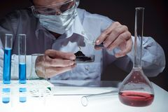 Young man scientist using auto-pipette with flask in medical science laboratory. Researcher concept. royalty free stock photo