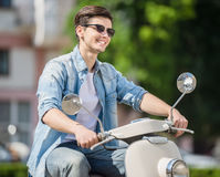 Young man on scooter Royalty Free Stock Image