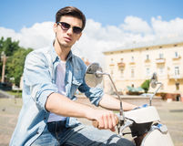 Young man on scooter Royalty Free Stock Photo