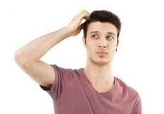 Young man scratching her head Royalty Free Stock Photos