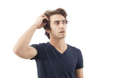 Young man scratching his head Royalty Free Stock Photography