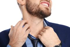 Young man scratching neck on white background. Annoying itch. Young man scratching neck on white background, closeup. Annoying itch stock images