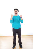 Young man screaming with clenched fists Royalty Free Stock Photo