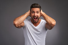 Young man screaming Stock Images