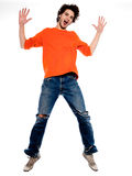 Young man screaming happy joy. One expressive caucasian young man screaming happy joy full length in studio on white background Stock Photos
