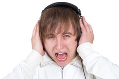 Young man screaming with headphones Stock Photography