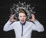 Young man screaming with his arms up Royalty Free Stock Images