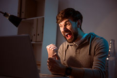 Young man screaming of joy Stock Images