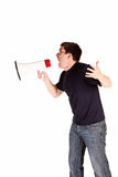 Young man screaming with megaphone Royalty Free Stock Image