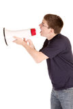 Young man screaming with megaphone Stock Photo