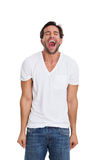 Young man screaming over white background Royalty Free Stock Images