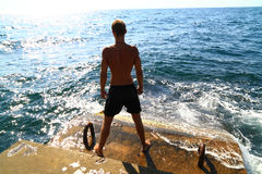 Young man and the sea stock photography