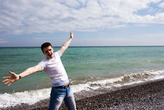 Young man and sea Stock Photography