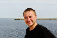 Young man at the sea. Royalty Free Stock Image