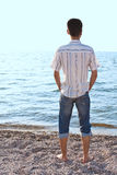 Young man on the sea coast. Stock Photography