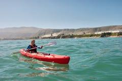 Young man in sea kayak royalty free stock image
