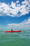Young man in sea kayak under dramatic skies Royalty Free Stock Images