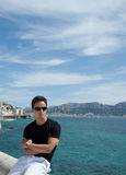 young man by the sea/ocean Stock Photography
