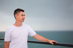 Young man on sea before storm Royalty Free Stock Photography