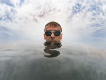 Young man in sea water with glasses Royalty Free Stock Photo