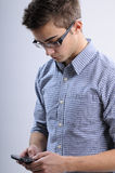 Young man searching. White, young, handsome man searching on mobile Royalty Free Stock Images