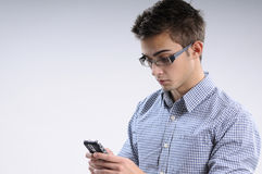 Young man searching. White, young, handsome man searching on mobile Stock Photography