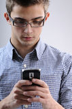 Young man searching. White, young, handsome man searching on mobile Royalty Free Stock Photos
