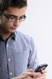 Young man searching. White, young, handsome man searching on mobile Stock Photo