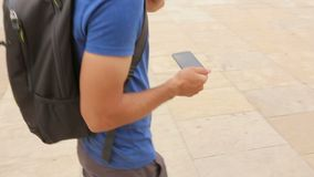 Young man searching for location on his smartphone, navigation application. Stock footage stock footage