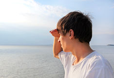 Young Man at Seaside. Young Man to gaze into the distance at the Seaside Royalty Free Stock Photos