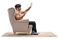 Young man using a virtual reality headset Stock Photos