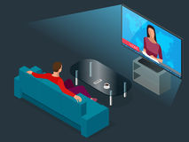 Young man seated on the couch watching tv, changing channels. Flat 3d vector isometric illustration. Stock Images