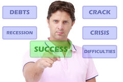 Young man selecting success Royalty Free Stock Image