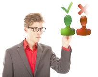 Young man selecting yes or no isolated Royalty Free Stock Photography